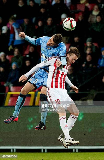 Mads Agesen of Randers FC and Rasmus Jonsson of AaB Aalborg compete for the ball during the Danish Alka Superliga match between AaB Aalborg and...