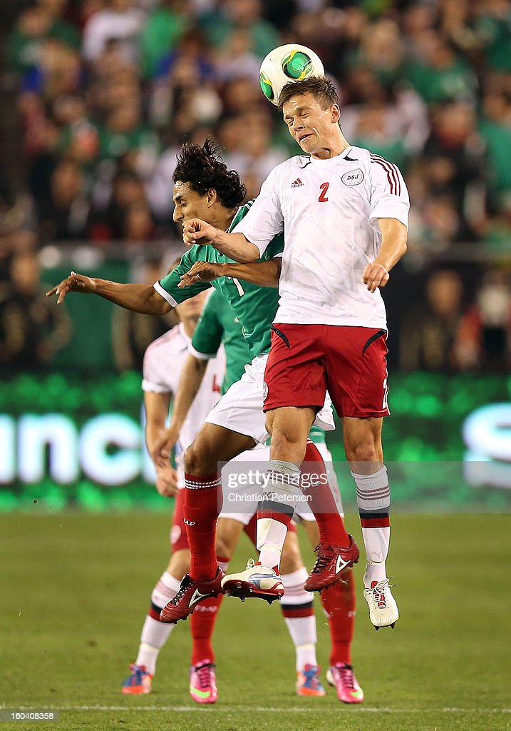 Mads Albaek #2 of Denmark and Fernando Arce #7 of Mexico go up for a header during an international friendly match at University of Phoenix Stadium on January 30, 2013 in Glendale, Arizona. Mexico and Denmark ended in a 1-1 draw.