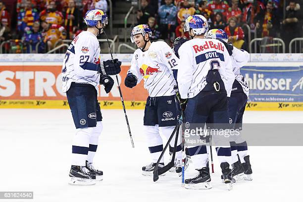Mads Christensen of Red Bull Muenchen celebrates after scoring a goal to make it 37 during the Ice Hockey DEL match between Duesseldorfer EG and Red...
