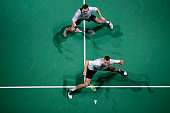 Mads Conrad Petersen and Mads Pieler Kolding of Denmark in action in their men's doubles match against Mathias Boe and Carsten Mogensen of Denmark...