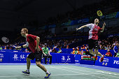 Mads ConradPetersen and Mathias Boe of Denmark compete during men's doubles match against Hiroyuki Endo and Kenichi Hayakawa of Japan in the Thomas...