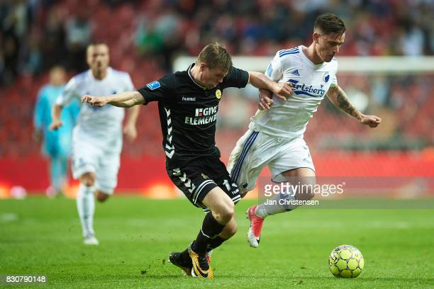 Mads Dohr Thychosen of AC Horsens and Benjamin Verbic of FC Copenhagen compete for the ball during the Danish Alka Superliga match between FC...