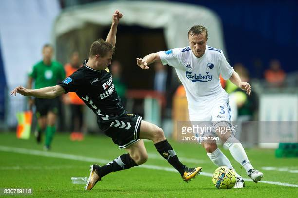 Mads Dohr Thychosen of AC Horsens and Pierre Bengtsson of FC Copenhagen compete for the ball during the Danish Alka Superliga match between FC...