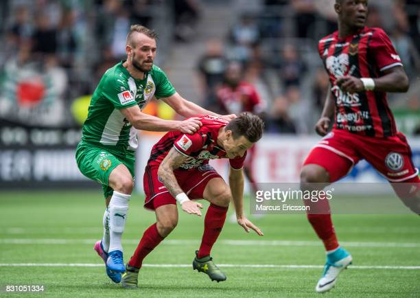 Mads Fenger Nielsen of Hammarby IF attacks Jamie Hopcutt of Ostersunds FK during the Allsvenskan match between Hammarby IF and Ostersunds FK at Tele2...