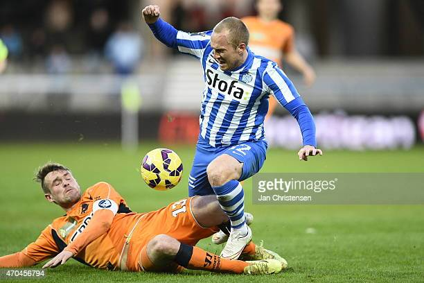 Mads Fenger of Randers FC and Daniel Larsson of Esbjerg FB compete for the ball during the Danish Alka Superliga match between Esbjerg fB and Randers...