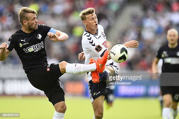 Mads Fenger of Randers FC and Kasper Junker of AGF Aarhus compete for the ball during the Danish Alka Superliga match between AGF Arhus and Randers...