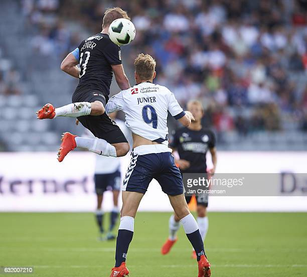 Mads Fenger of Randers FC and Kasper Junker of AGF Arhus compete for the ball during the Danish Alka Superliga match between AGF Arhus and Randers FC...
