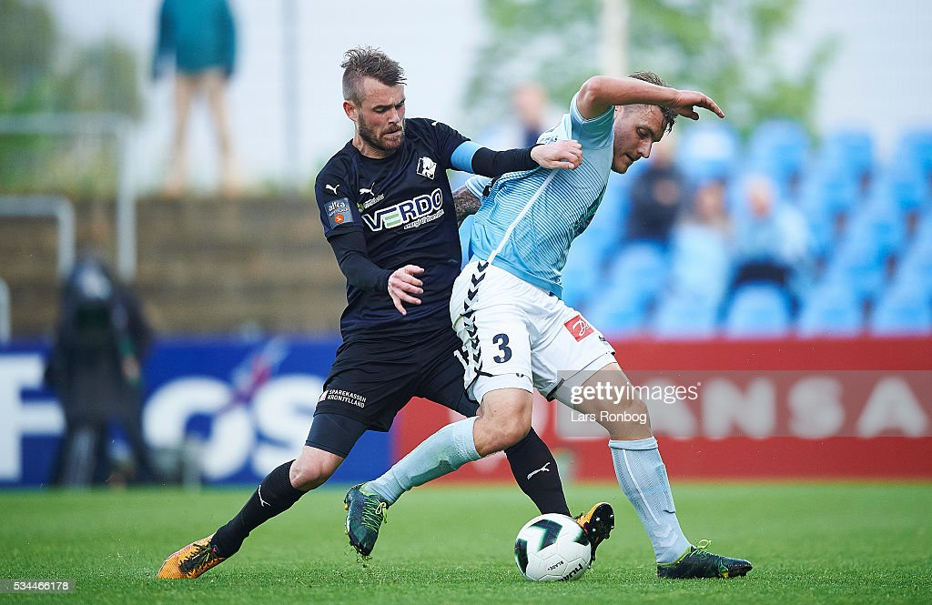 Mads Fenger of Randers FC and Marc Pedersen of Sonderjyske compete for the ball during the Danish Alka Superliga match between Sonderjyske and Randers FC at Sydbank Park on May 26, 2016 in Haderslev, Denmark.