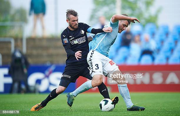 Mads Fenger of Randers FC and Marc Pedersen of Sonderjyske compete for the ball during the Danish Alka Superliga match between Sonderjyske and...