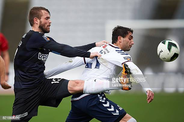Mads Fenger of Randers FC and Mate Vatsadze of AGF Aarhus compete for the ball during the Danish Alka Superliga match between AGF Aarhus and Randers...