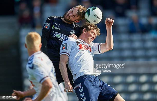 Mads Fenger of Randers FC and Morten Duncan Rasmussen of AGF Aarhus compete for the ball during the Danish Alka Superliga match between AGF Aarhus...