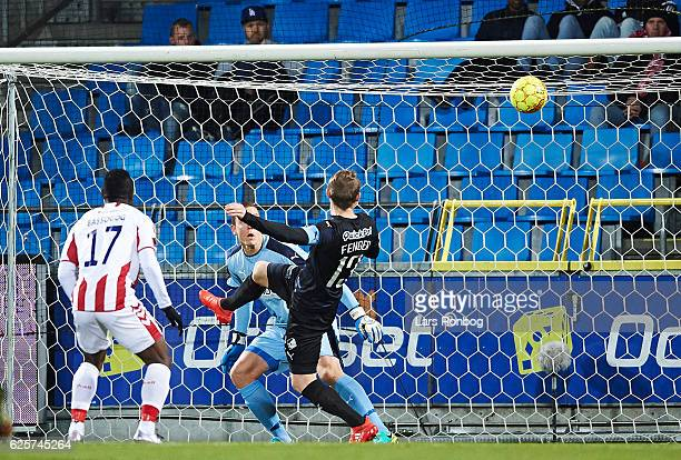 Mads Fenger of Randers FC scores an own goal against his Goalkeeper Hannes Thor Halldorsson of Randers FC during the Danish Alka Superliga match...