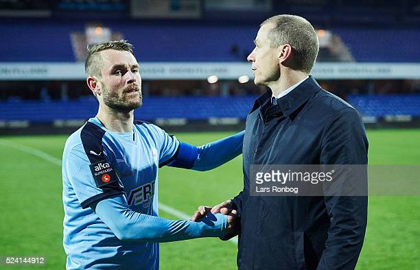 Mads Fenger of Randers FC shake hands with Michael Gravgaard CEO of Randers FC after the Danish Alkla Superliga match between Randers FC and AaB...