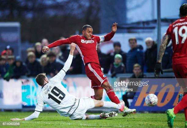 Mads Greve of Vendsyssel FF Mathias Zanka Jorgensen of FC Copenhagen and Goalkeeper Jesper Christiansen of Vendsyssel FF compete for the ball during...