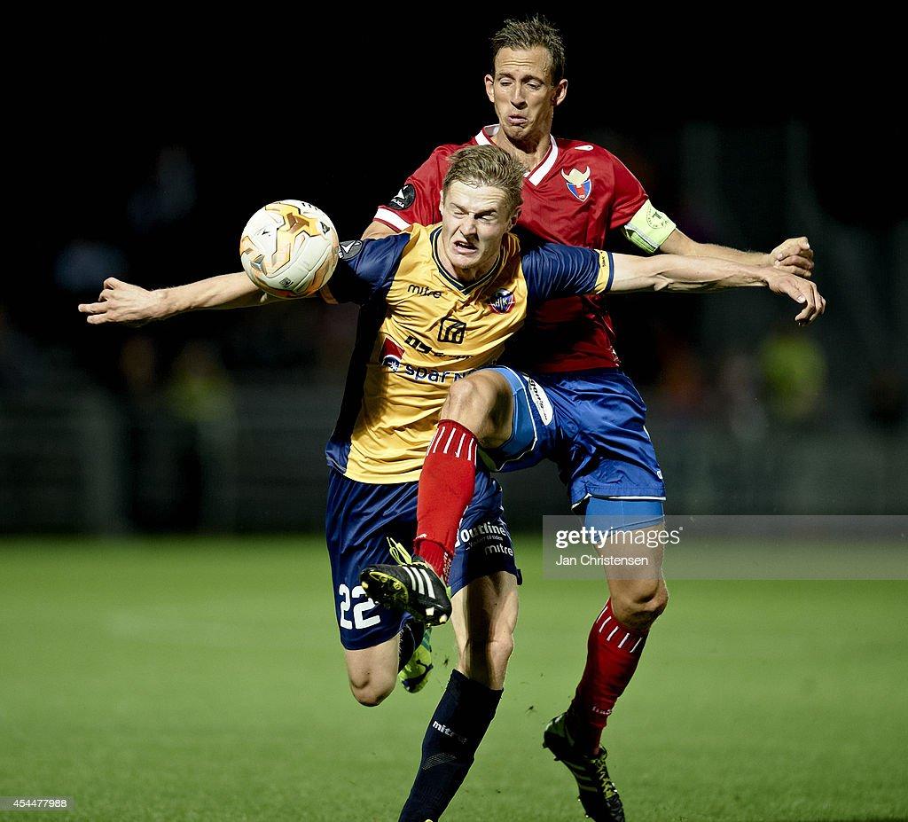 Mads Hvilsom of Hobro IK (L) and Henrik Madsen of FC Vestsjalland compete for the ball during the Danish Superliga match between Hobro IK and FC Vestsjalland at DS Arena on September 01, 2014 in Hobro, Denmark.