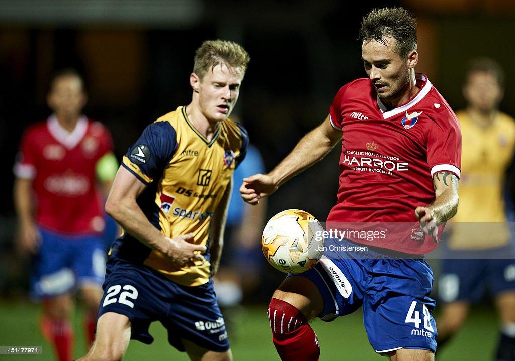 Mads Hvilsom of Hobro IK (L) and Oliver Lund of FC Vestsjalland compete for the ball during the Danish Superliga match between Hobro IK and FC Vestsjalland at DS Arena on September 01, 2014 in Hobro, Denmark.