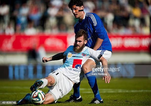 Mads Jessen of Hobro IK and Rasmus Minor Petersen of Lyngby Boldklub compete for the ball during the Danish NordicBet Ligaen match between Lyngby...