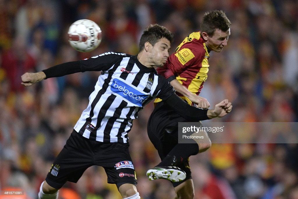 Mads Junker of KV Mechelen battles for the ball with Javier Fransisco Martos of Charleroi during the Jupiler Pro League play off 2 match between KV Mechelen and Royal Charleroi Sporting Club on March 30, 2014 in Mechelen, Belgium.