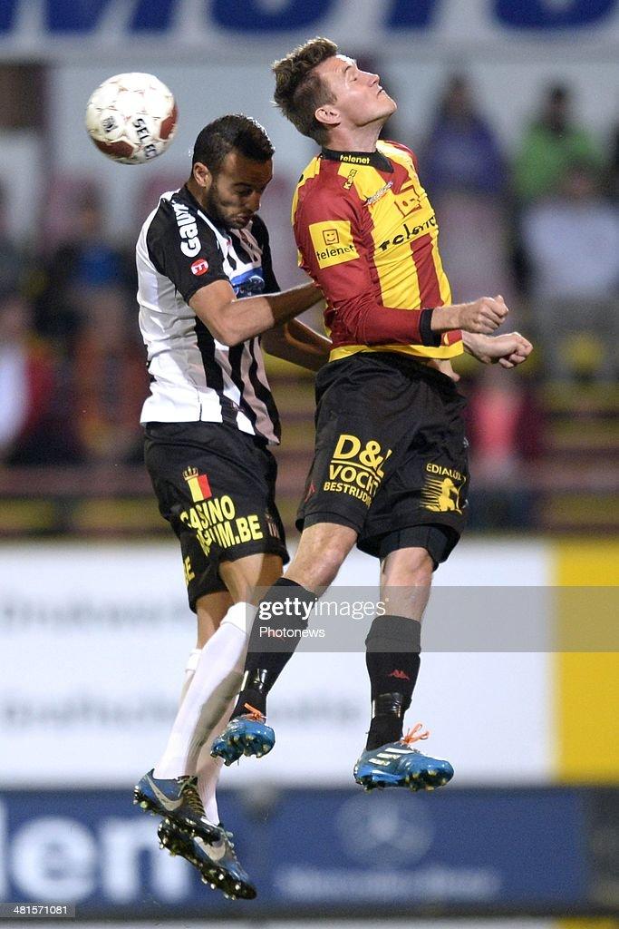 Mads Junker of KV Mechelen battles for the ball with Mourad Satli of Charleroi during the Jupiler Pro League play off 2 match between KV Mechelen and Royal Charleroi Sporting Club on March 30, 2014 in Mechelen, Belgium.