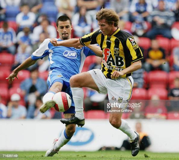 Mads Junker of Vittesse battles for the ball with Paul Scharner of Wigan during the Pre Season Friendly between Wigan Athletic and Vitesse Arnhem at...