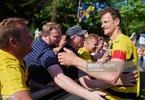 Mads Justesen of Hobro IK celebrates with fans winning the match and the NordicBet LIGA with promotion to the Alka Superliga after the Danish...