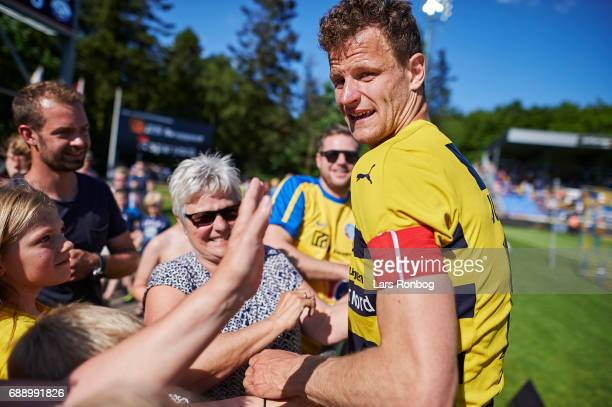 Mads Justesen of Hobro IK celebrates with his family winning the match and the NordicBet LIGA with promotion to the Alka Superliga after the Danish...