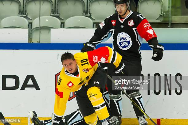 Mads Lund of Vojens and Andreas Driendl of Krefeld Pinguine have a little fight during the Champions Hockey League group stage game between...
