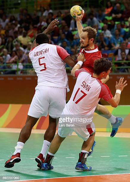 Mads Mensah Larsen and Lasse Svan of Denmark block during the Men's Handball Semifinal match between Poland and Denmark on Day 14 of the Rio 2016...