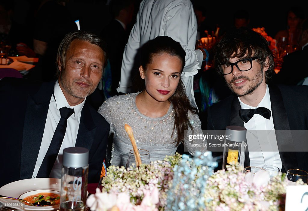 Mads Mikkelsen, Alicia Vikander and guest attend the Gala Dinner for amfAR's 20th Annual Cinema Against AIDS at Hotel du Cap-Eden-Roc on May 23, 2013 in Cap d'Antibes, France.