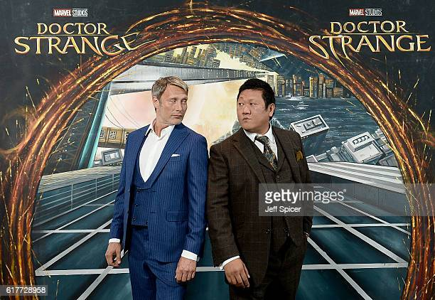 Mads Mikkelsen and Benedict Wong in front of the Doctor Strange inspired 3D Art at a fan screening to celebrate the release of Marvel Studio's Doctor...