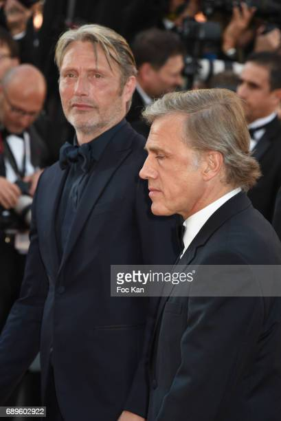 Mads Mikkelsen and Christoph Waltz attend the 70th anniversary event during the 70th annual Cannes Film Festival at Palais des Festivals on May 23...