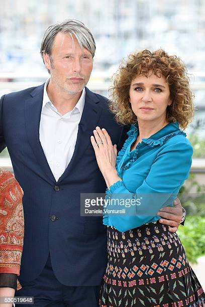 Mads Mikkelsen and Valeria Golino attend the Jury Photocall during the 69th Annual Cannes Film Festival at the Palais des Festivals on May 11 2016 in...