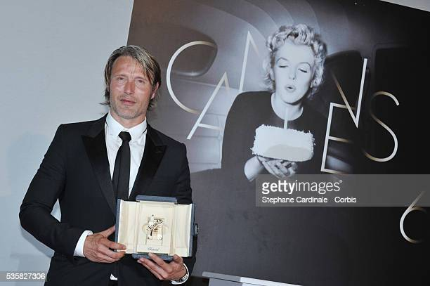 Mads Mikkelsen poses with his Best Actor Award for his role in The Hunt at the Winners Photocall during the 65th Cannes International Film Festival