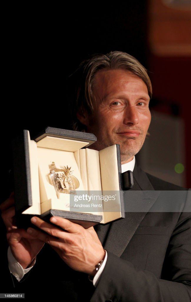 <a gi-track='captionPersonalityLinkClicked' href=/galleries/search?phrase=Mads+Mikkelsen&family=editorial&specificpeople=3003791 ng-click='$event.stopPropagation()'>Mads Mikkelsen</a>, with his Best Actor Award for his role in 'The Hunt' smiles as he attends the Winners Press Conference during the 65th Annual Cannes Film Festival on May 27, 2012 in Cannes, France.
