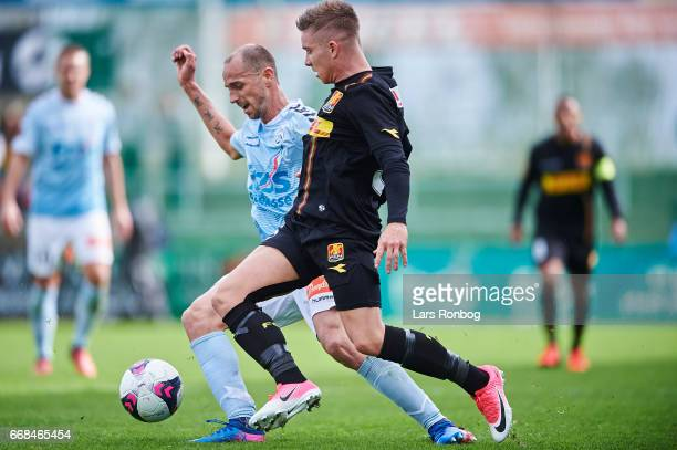 Mads Mini Pedersen of FC Nordsjalland and Sakari Mattila of Sonderjyske compete for the ball during the Danish Alka Superliga match between...