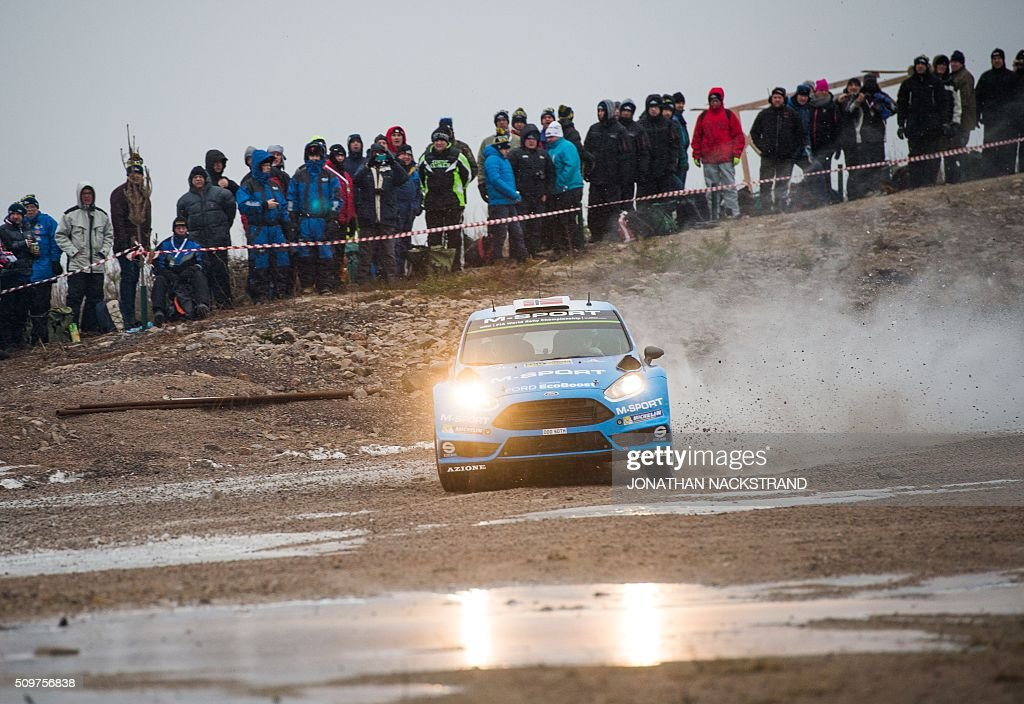 Mads Ostberg of Norway and his co-driver Ola Floene steer their Ford Fiesta RS WRC during the 2nd stage of the Rally Sweden, second round of the FIA World Rally Championship on February 12, 2016 in Torsby, Sweden. / AFP / JONATHAN NACKSTRAND