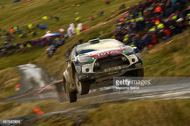 Mads Ostberg of Norway and Jonas Andersson of Sweden compete in their Citroen Total Abu Dhabi WRT Citroen DS3 WRC during Day One of the WRC Wales...