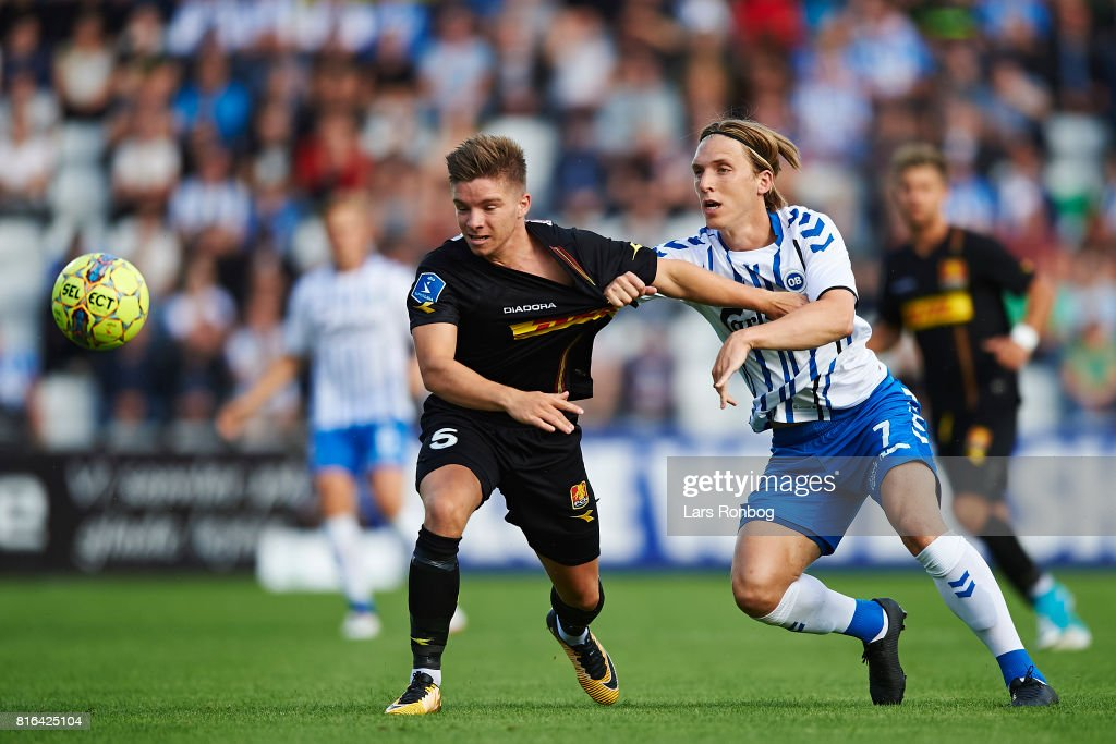 Mads Pedersen of FC Nordsjalland and Joan Simun Edmundsson of OB Odense compete for the ball during the Danish Alka Superliga match between OB Odense and FC Nordsjalland at EWII Park on July 17, 2017 in Odense, Denmark.