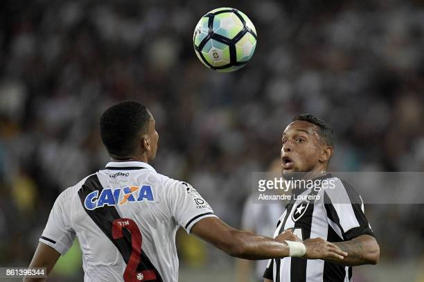 Madson of Vasco da Gama battles for the ball with Guilherme of Botafogo during the match between Vasco da Gama and Botafogo as part of Brasileirao...