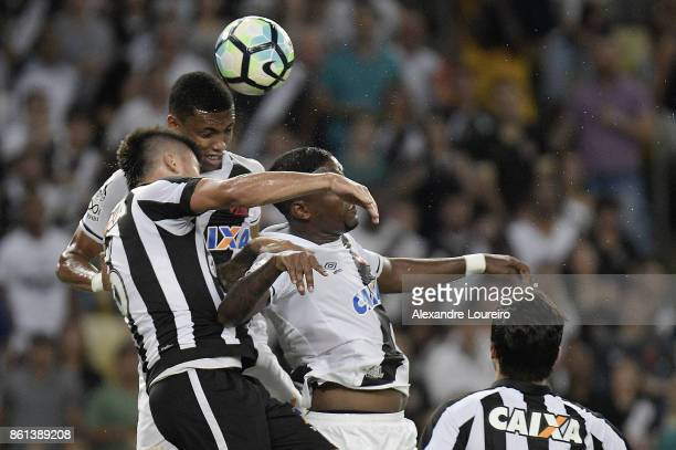 Madson of Vasco da Gama battles for the ball with Victor Luis of Botafogo during the match between Vasco da Gama and Botafogo as part of Brasileirao...