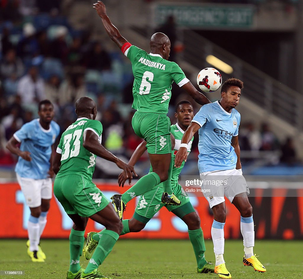 Madubanya Letladi of AmaZulu jumps into Scott Sinclair of Manchester City during the Nelson Mandela Football Invitational match between AmaZulu and Manchester City at Moses Mabhida Stadium on July 18, 2013 in Durban, South Africa.