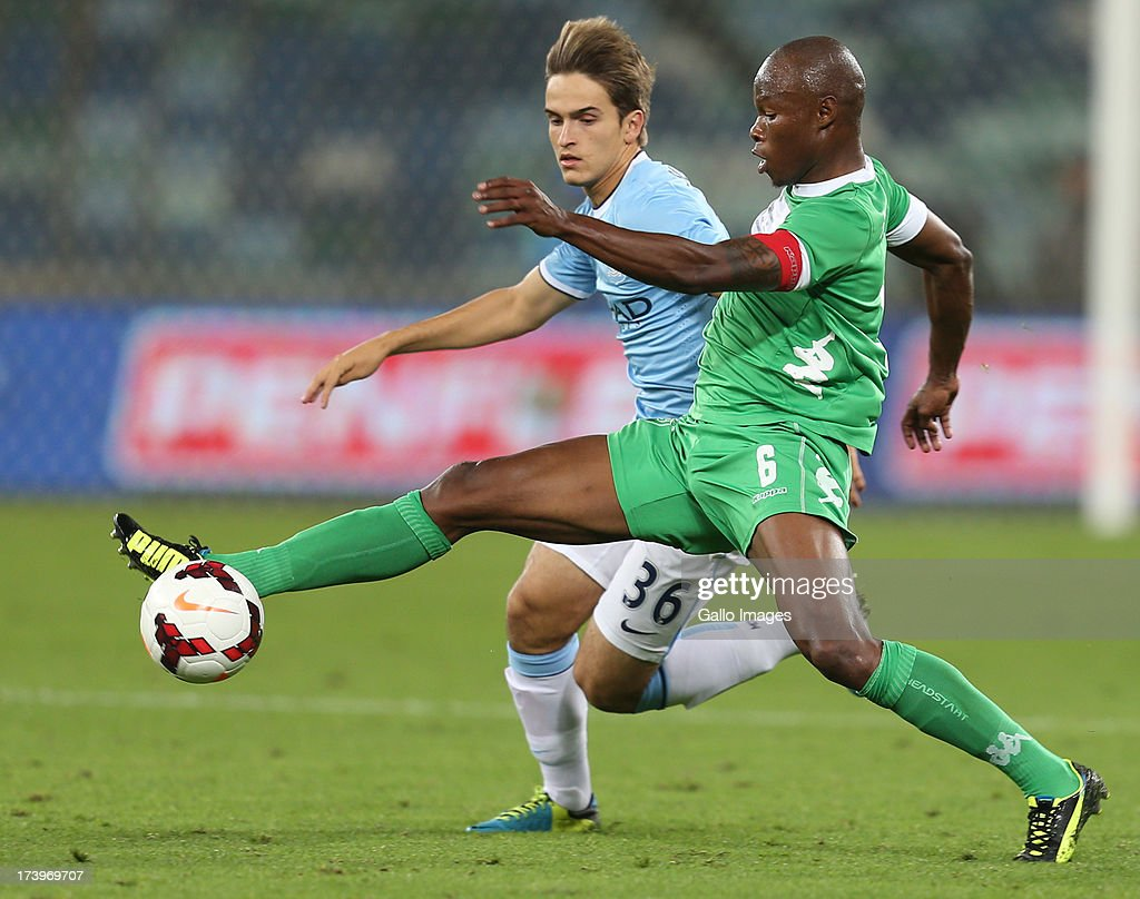 Madubanya Letladi of AmaZulu keeps the ball away from Denis Suarez of Manchester City during the Nelson Mandela Football Invitational match between AmaZulu and Manchester City at Moses Mabhida Stadium on July 18, 2013 in Durban, South Africa.