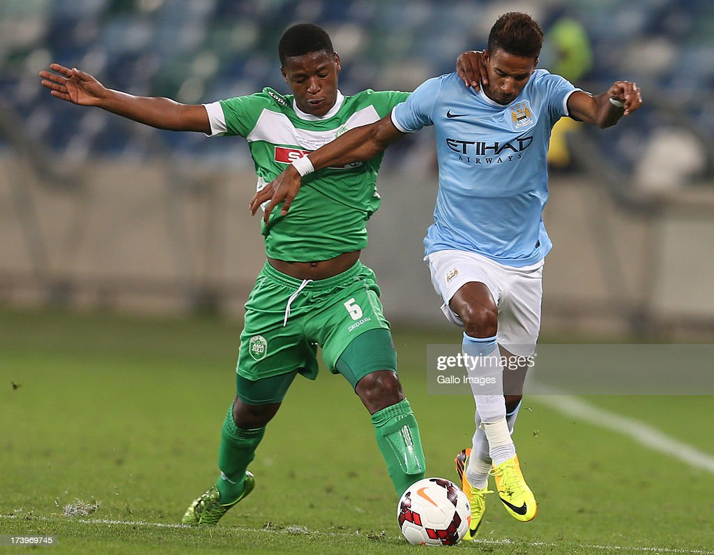 Madubanya Letladi of AmaZulu with a tackle on Scott Sinclair of Manchester City during the Nelson Mandela Football Invitational match between AmaZulu and Manchester City at Moses Mabhida Stadium on July 18, 2013 in Durban, South Africa.