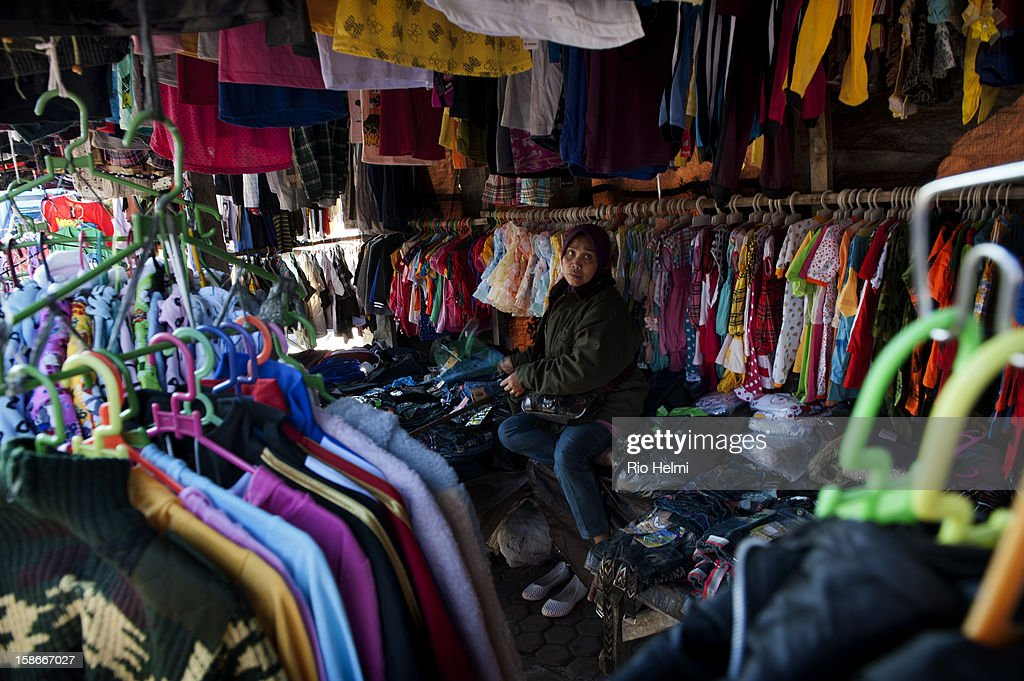 Madurese Muslim woman sells used and factory reject clothes from her stall in the Kintamani markets. The Madurese are aggresive small businessmen and are found in neraly every traditional retail market in Bali..