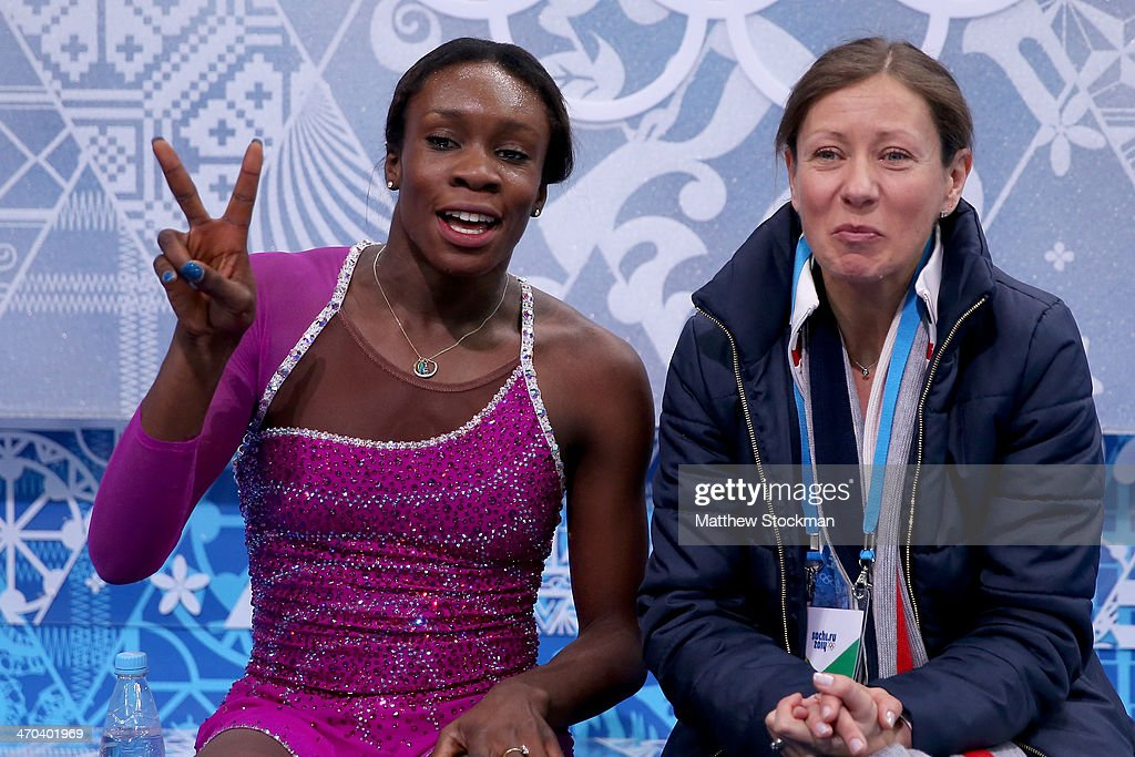Mae Berenice Meite (L) of France waits for her score with her coach Katia Krier Beyer in the Figure Skating Ladies' Short Program on day 12 of the Sochi 2014 Winter Olympics at Iceberg Skating Palace on February 19, 2014 in Sochi, Russia.