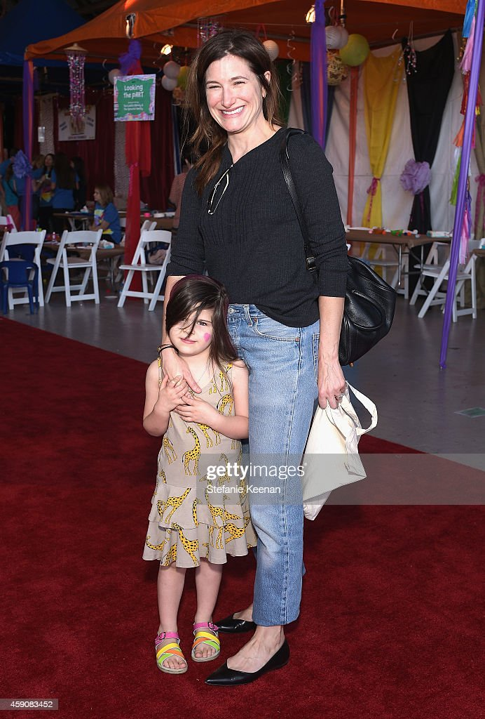 Mae Sandler (L) and actress Kathryn Hahn attend P.S. ARTS presents Express Yourself 2014 with sponsors OneWest Bank and Jaguar Land Rover at Barker Hangar on November 16, 2014 in Santa Monica, California.