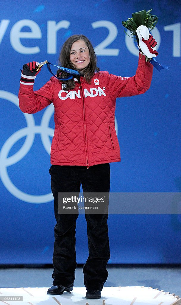 Maelle Ricker of Canada celebrates winning the gold medal during the medal ceremony for the Ladies' Snowboard Cross on day 6 of the Vancouver 2010 Winter Olympics at BC Place on February 17, 2010 in Vancouver, Canada.