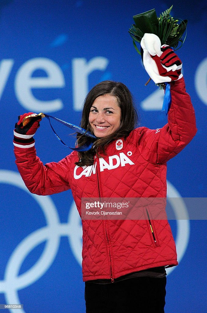 Maelle Ricker of Canada celebrates with her gold medal during the medal ceremony for the Ladies' Snowboard Cross on day 6 of the Vancouver 2010 Winter Olympics at BC Place on February 17, 2010 in Vancouver, Canada.
