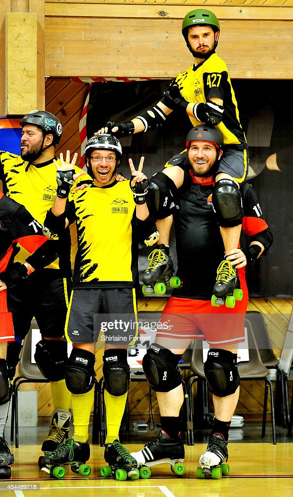 Maelstrom and Aligator of Panam Squad and Bravehurt of Quad Guards celebrate at the Men's European Cup roller derby tournament at Walker Activity Dome on August 31, 2014 in Newcastle upon Tyne, England.