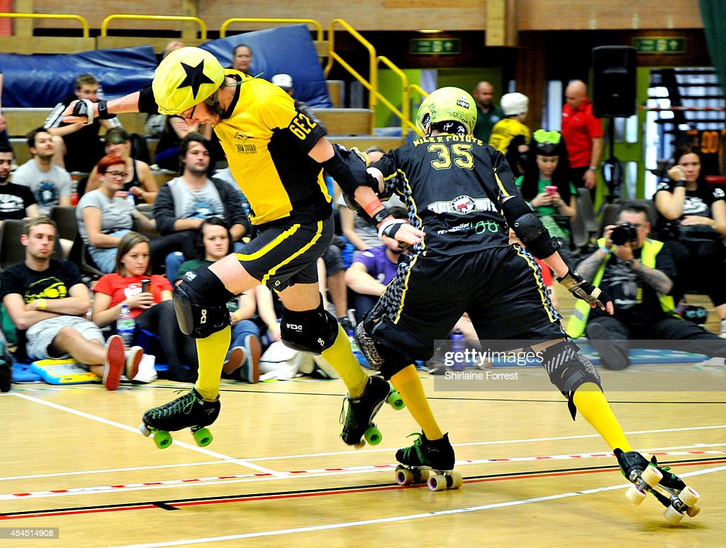 Maelstrom of Panam Squad and Rile E. Coyote of Crash Test Brummies bout in the Men's European Cup roller derby tournament at Walker Activity Dome on August 31, 2014 in Newcastle upon Tyne, England.